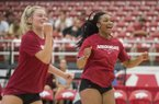 Arkansas volleyball players Allyson Dernehl (left) and Elizabeth Pamphile celebrate a point Saturday, Aug. 11, 2018, during a scrimmage at Barnhill Arena in Fayetteville.