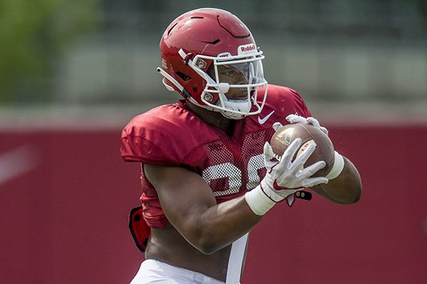 Arkansas linebacker Andrew Parker catches a ball during practice Wednesday, Aug. 8, 2018, in Fayetteville.