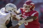 Arkansas defensive end Dorian Gerald goes up against a Tulsa offensive lineman during a game Saturday, Oct. 20, 2018, in Fayetteville.