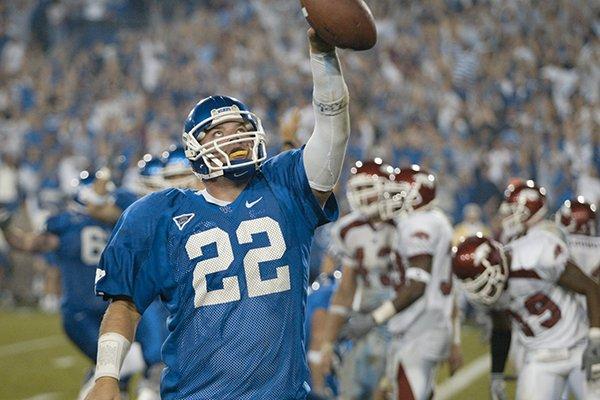 Kentucky quarterback Jared Lorenzen celebrates a touchdown run against Arkansas during a game Saturday, Nov. 1, 2003, in Lexington, Ky.