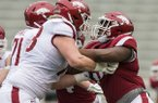Arkansas defensive end Eric Gregory (right) is shown during the Razorbacks' Red-White Game on Saturday, April 6, 2019, in Fayetteville.