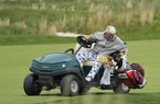 John Daly picks up his bag to pull his putter on the 18th hole during the second round of the PGA Championship golf tournament, Friday, May 17, 2019, at Bethpage Black in Farmingdale, N.Y. (AP Photo/Andres Kudacki)