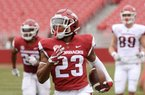 """Arkansas freshman cornerback Devin Bush, shown returning an interception for a touchdown during the Razorbacks' spring game in April, plans to major in finance when classes begin in the fall. """"I plan on having like an empire,"""" he said."""