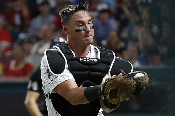 American League catcher James McCann, of the Chicago White Sox, catches pop up in foul territory by National League Mike Moustakas, of the Milwaukee Brewers, to end the top of the eighth inning of the MLB baseball All-Star Game, Tuesday, July 9, 2019, in Cleveland. (AP Photo/John Minchillo)