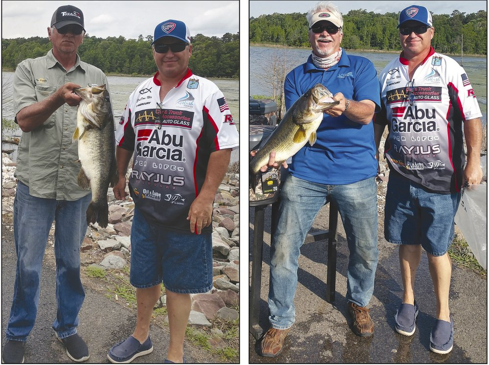 Overall winner Tim Denman (left), with his 7.92-pound bass, and Eric Morrison (right), with a 6.92-pounder, in this May 18, 2019, Banner-News file photo show off the top two bass caught on Lake Columbia during the annual Tom Dehoney Big Bass Tournament. Also pictured is tournament official JoeDon Nix.