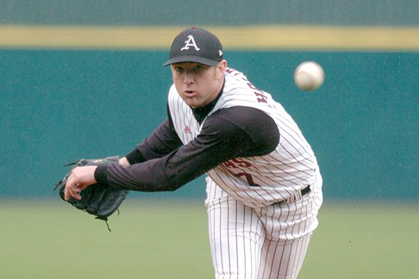 Arkansas senior reliever Trey Holloway delivers a pitch during the Hogs' 4-3 win over Minnesota on Sunday, Feb. 27, 2005, at Baum Stadium in Fayetteville. Holloway pitched four innings of one-hit baseball in the win.