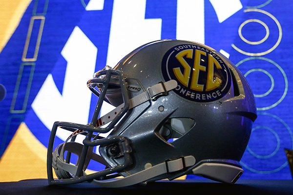 A helmet sits on the podium as the NCAA college football Southeastern Conference Media Days begins, Monday, July 15, 2019, in Hoover, Ala. (AP Photo/Butch Dill)