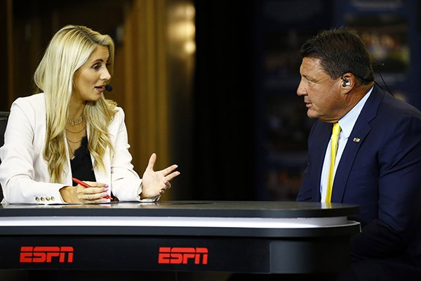 ESPN's Laura Rutlegde interviews Head Coach Ed Orgeron, of LSU, during the NCAA college football Southeastern Conference Media Days, Monday, July 15, 2019, in Hoover, Ala. (AP Photo/Butch Dill)
