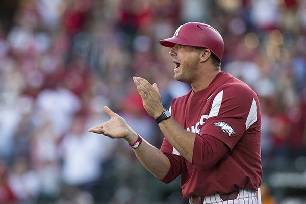 Arkansas assistant coach Nate Thompson encourages players during a game against Tennessee on Saturday, April 27, 2019, in Fayetteville.