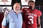 Arkansas defensive coordinator John Chavis and Aaron Moore
