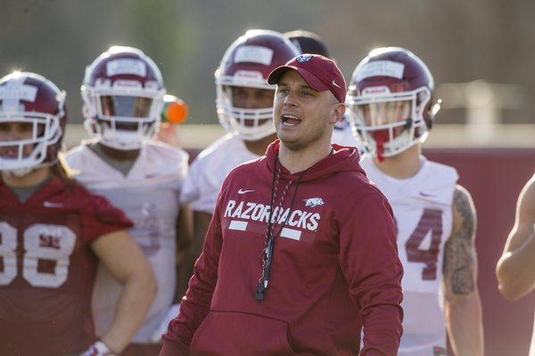 Justin Stepp, Arkansas wide receivers coach, runs a drill Thursday, March 1, 2018, during Arkansas spring football practice at the Fred W. Smith Football Center in Fayetteville.