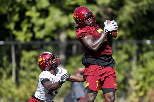 Iowa State wide receiver La'Michael Pettway catches a pass over defensive back Jaeveyon Morton, left, during an NCAA college football practice, Friday, Aug. 2, 2019, in Ames, Iowa. (AP Photo/Charlie Neibergall)