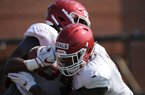 Arkansas defensive lineman Dorian Gerald (right) wraps up David Porter Tuesday, Aug. 6, 2019, during practice at the university practice field. Visit nwadg.com/photos to see more photographs from the practice.
