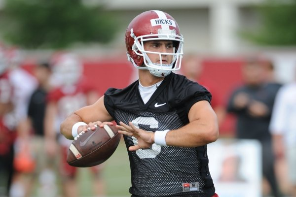 Arkansas quarterback Ben Hicks looks to pass Friday, Aug. 2, 2019, during practice at the university practice field in Fayetteville. Visit nwad.com/photos to see more photographs from the practice.