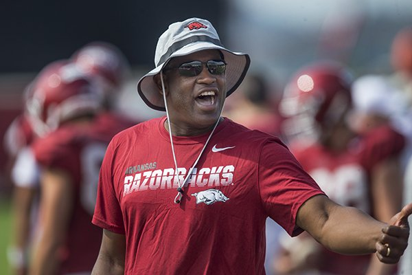 Turner Gill is shown at an Arkansas football practice on Wednesday, Aug. 7, 2019, in Fayetteville. Gill in his first season in a non-coaching role on the Razorbacks' football staff.