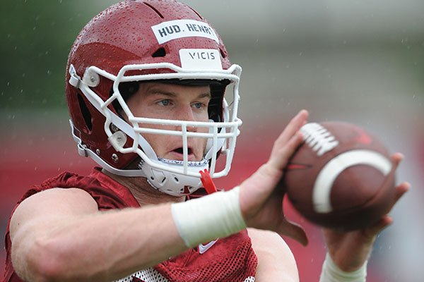 Arkansas tight end Hudson Henry (82) makes a catch Saturday, Aug. 3, 2019, during practice at the university practice field in Fayetteville.