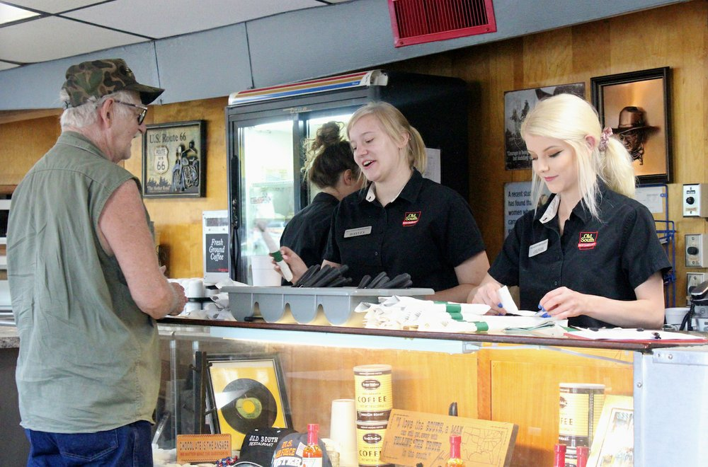 Members of the Old South's wait staff serve a local customer Aug. 1. (Special to the Democrat-Gazette/ELI CRANOR)