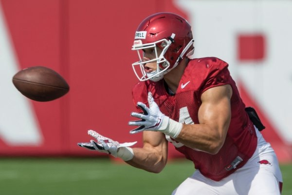 Chase Harrell, Arkansas tight end, catches a pass Wednesday, Aug. 7, 2019, at the Arkansas practice fields in Fayetteville.