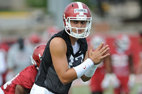 Arkansas quarterback Nick Starkel waits for the snap Friday, Aug. 2, 2019, during practice at the university practice field in Fayetteville.