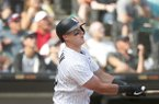 Chicago White Sox's James McCann watches his grand slam during the eighth inning of a baseball game against the Houston Astros Wednesday, Aug. 14, 2019, in Chicago. (AP Photo/Charles Rex Arbogast)