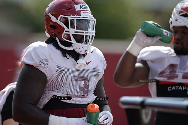 Arkansas defensive lineman McTelvin Agim is shown Tuesday, Aug. 13, 2019, during practice at the university practice facility in Fayetteville.
