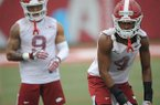 Arkansas defensive backs Jarques McClellion (4) and Greg Brooks Jr. (9) line up for a drill Saturday, Aug. 3, 2019, during practice at the university practice field in Fayetteville.