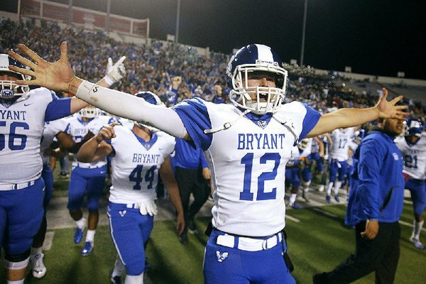 Bryant quarterback Austin Ledbetter celebrates after the Hornets' 27-7 victory over North Little Rock in the Class 7A state championship game at War Memorial Stadium in Little Rock. Ledbetter returns for his junior season, and the Hornets open as the No. 1 team in the Arkansas Democrat-Gazette's overall rankings.