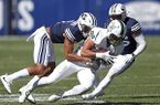 BYU's Troy Warner, left, tackles Portland State tight end Charlie Taumoepeau (89) in the second half during an NCAA college football game Saturday, Aug. 26, 2017, in Provo, Utah. (AP Photo/Rick Bowmer)