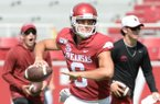 Arkansas quarterback Ben Hicks rolls out to pass Saturday, Aug. 24, 2019, during practice in Razorback Stadium in Fayetteville. Visit nwadg.com/photos to see more photographs from the day and the team's scrimmage.