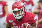 Arkansas holds a scrimmage game Saturday, Aug. 24, 2019, during fan day at Reynolds Razorback Stadium in Fayetteville.