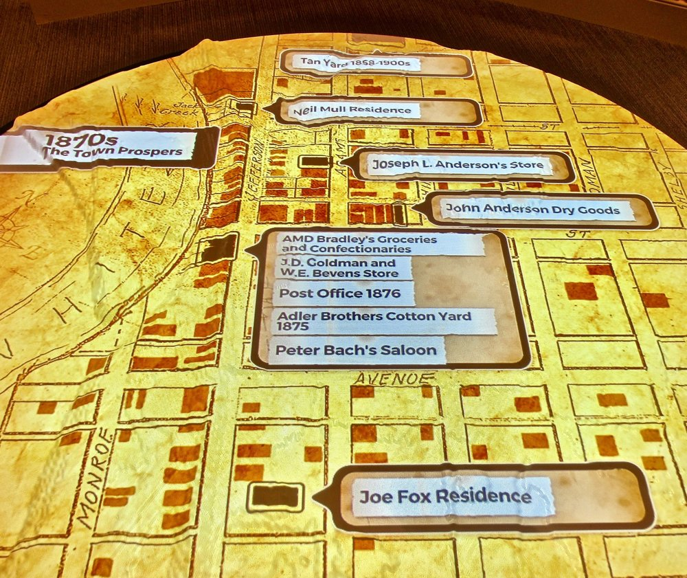 An illuminated map at Jacksonport State Park Visitor Center shows the layout of streets and businesses in decades of rise and decline. (Photo by Marcia Schnedler, special to the Democrat-Gazette)