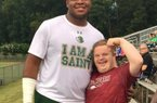 DT Omari Thomas and super fan Canaan Sandy.