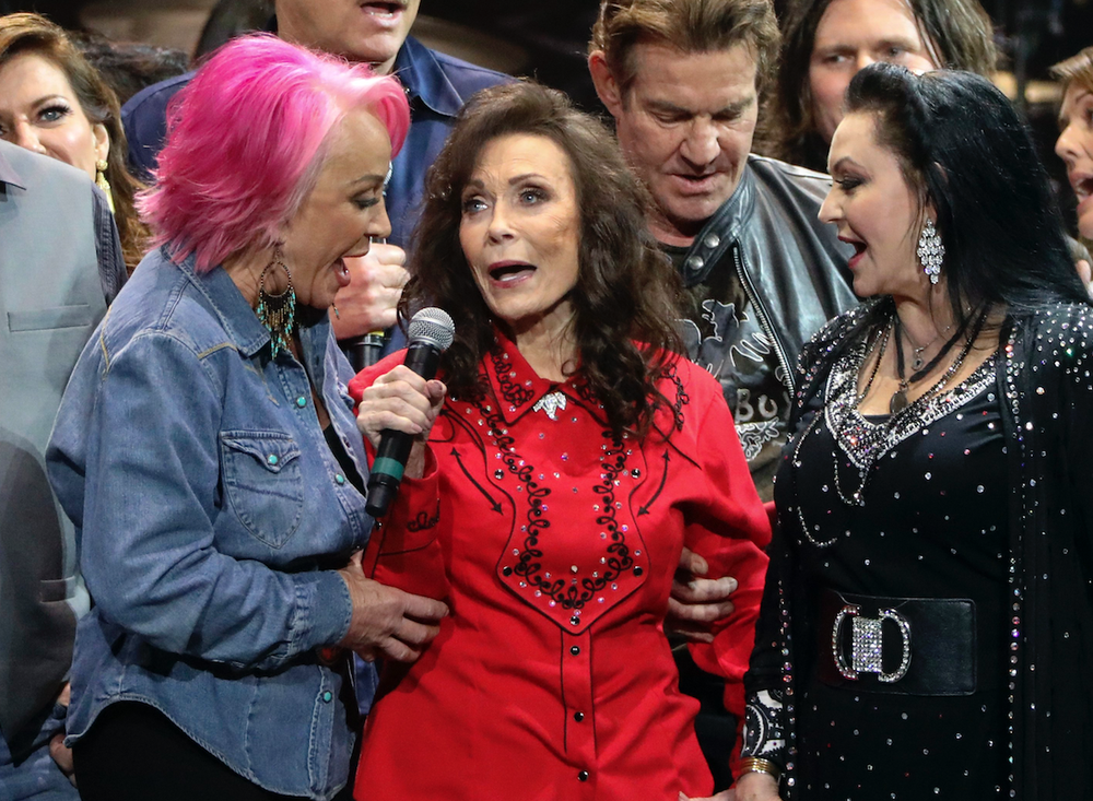 Tanya Tucker (left), Loretta Lynn (center) and Crystal Gayle perform at Loretta Lynn's 87th Birthday Tribute on April 1 in Nashville. (AP)