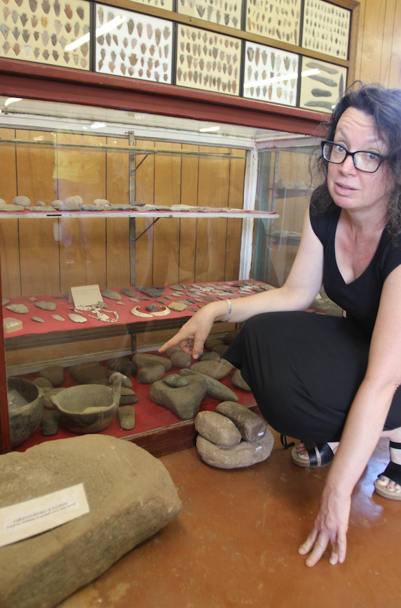 Jodi Barnes points to an effigy bowl in the Desha County Museum's collection. Barnes, Archeological Survey Station Archeologist at the University of Arkansas at Monticello, says the museum's collection has yet to be categorized or authenticated.
