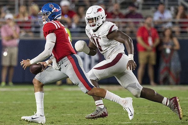 Arkansas defensive end Mataio Soli (11) chases Ole Miss quarterback Matt Corral during a game Saturday, Sept. 7, 2019, in Oxford, Miss.