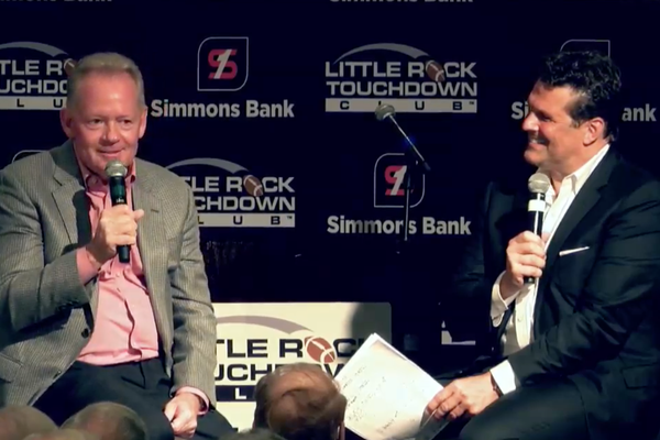 Former University of Arkansas head football coach Bobby Petrino and David Bazzel speak before the club on Monday in this still captured from video provided by the Little Rock Touchdown Club.