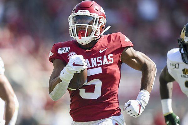 Arkansas running back Rakeem Boyd carries the ball during a game against Colorado State on Saturday, Sept. 14, 2019, in Fayetteville.