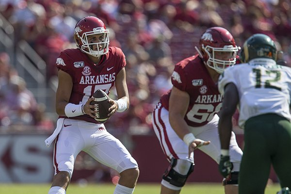 Arkansas quarterback Nick Starkel takes a snap during a game against Colorado State on Saturday, Sept. 14, 2019, in Fayetteville.
