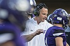 Casey Dick, Fayetteville head coach, congratulates players after a turnover in the first quarter vs St. Louis Vianney Friday, Aug. 30, 2019, at Fayetteville's Harmon Stadium.
