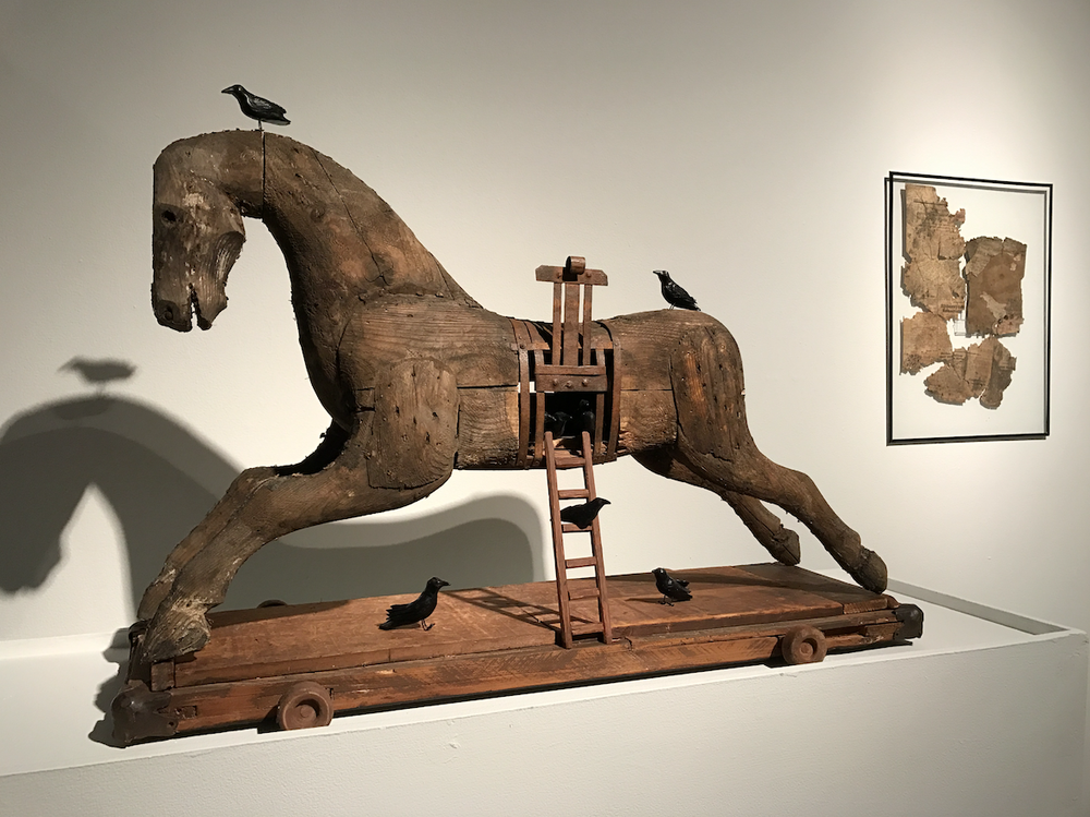 """The symbolism of a Trojan horse informs V.L. Cox's """"Dark Horse."""" The mixed media work includes a carved horse from 1942. It is part of """"Break Glass: A Conversation to End Hate,"""" which opens Friday at the Delta Cultural Center in Helena-West Helena. (Courtesy V.L. Cox)"""