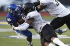 North Little Rock receiver Johnny Lewis (left) is hit by Memphis Whitehaven linebacker Martavius French during Friday night's game at North Little Rock.