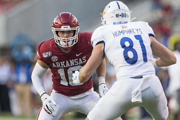 Arkansas linebacker Bumper Pool covers San Jose State tight end Billy Humphreys during a game Saturday, Sept. 21, 2019, in Fayetteville.