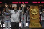 Former Arkansas coach Nolan Richardson calls the hogs with members of the 1994 Razorback National Championship basketball team during half time of an NCAA college basketball game, Saturday, March 2, 2019 in Fayetteville. The ceremony marked the 25-year anniversary of the National Championship game. (AP Photo/Michael Woods)