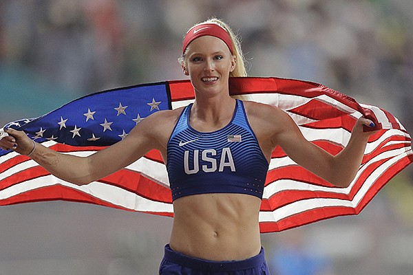 Sandi Morris, of the United States smiles after her silver in the women's pole vault final at the World Athletics Championships in Doha, Qatar, Sunday, Sept. 29, 2019. (AP Photo/Petr David Josek)