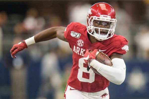 Mike Woods, Arkansas wide receiver, picks up yards after a catch in the third quarter vs Texas A&M Saturday, Sept. 28, 2019, at AT&T Stadium in Arlington, Texas.
