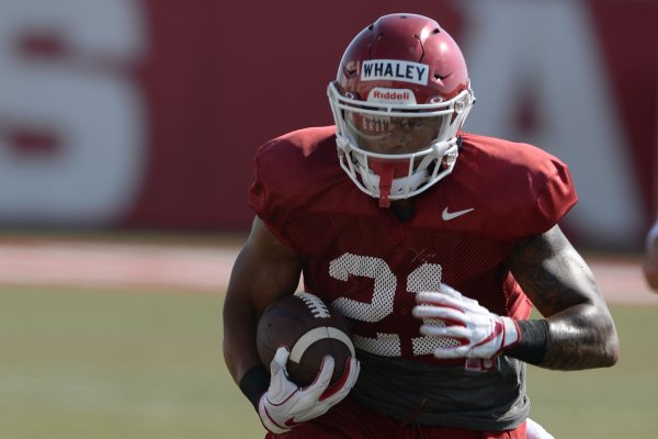 Arkansas running back Devwah Whaley carries the ball Tuesday, Aug. 20, 2019, during practice at the university's practice facility in Fayetteville.
