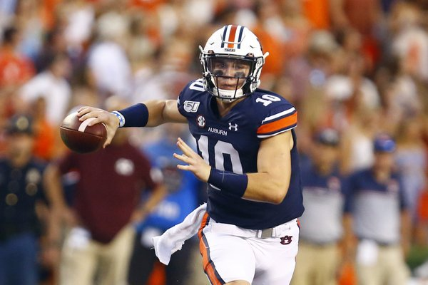 Auburn quarterback Bo Nix (10) rolls out to pass during the first half of an NCAA college football game against Mississippi State, Saturday, Sept. 28, 2019, in Auburn, Ala.