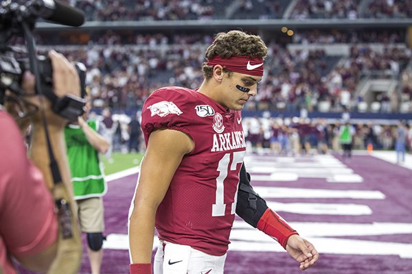 Arkansas quarterback Nick Starkel walks off the field following the Razorbacks' 31-27 loss to Texas A&M on Saturday, Sept. 28, 2019, in Arlington, Texas.