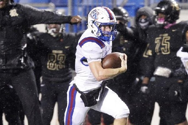 Arkadelphia quarterback Cannon Turner breaks free on a 69-yard touchdown run during the Badgers' 28-0 victory over Joe T. Robinson in Saturday night's Class 4A championship game at War Memorial Stadium in Little Rock.