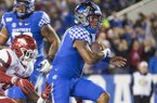 Kentucky quarterback Lynn Bowden Jr. (1) rushes for a touchdown during a game against Arkansas on Saturday, Oct. 12, 2019, in Lexington, Ky.